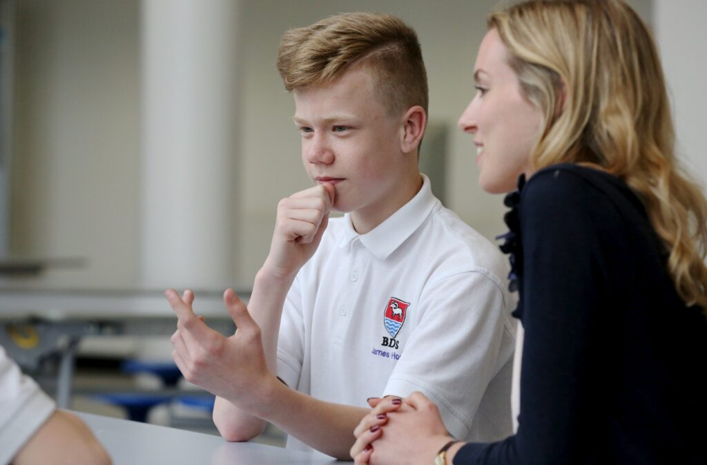 A WEM business mentor and student